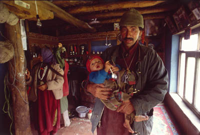 Stock photo of Himalayan man and child in home